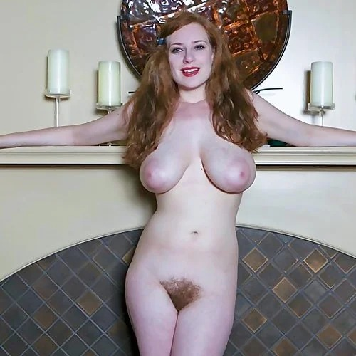 Busty Redhead Misha Lowe By The Fire Place